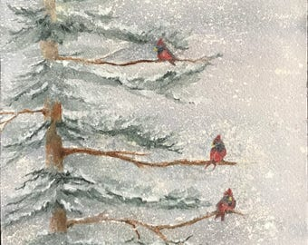 Fine Art Watercolor Image with Cardinals on Pine Tree Branches On A Snowy Blizzard,Frigid, Cold Winter Day by Janet Dosenberry