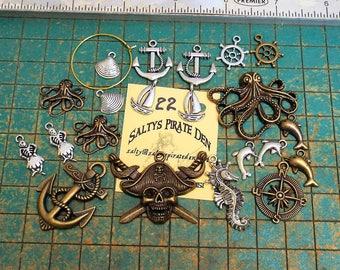 21 nautical charms, anchors, sailboat, seahorse, dolphins, kraken, skull crossbones, pirate, sailors delight, ships wheel,