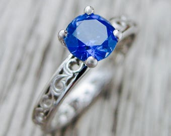 Blue Sapphire Engagement Ring in 18K White Gold with Floral Scroll Pattern Size 6