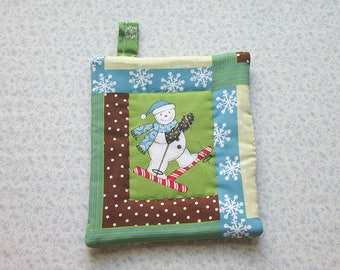 snowman on candy cane skis hand quilted insulated potholder hot pad with loop to hang