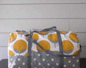 Adventurer overnight duffel bag in modern marigold