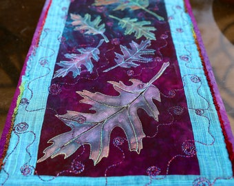 MarveLes AUTUMN GLOW Leaves in purple, turquoise, teal, hand painted Quilted Table Topper or Wall Hanging