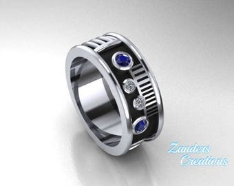 Saber Ring with blue synthetic sapphire and CZ's set in Sterling silver