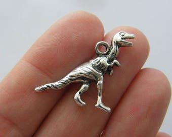 4 Dinosaur Velociraptor charms antique silver tone A652