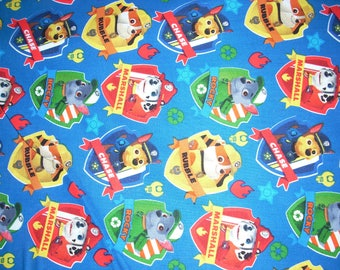 Paw Patrol Patches on blue -  Cotton Fabric - 44 inches wide and sold by the yard