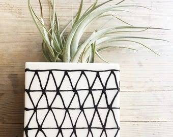 medium porcelain planter / wall vase hand painted triangles pattern in black.