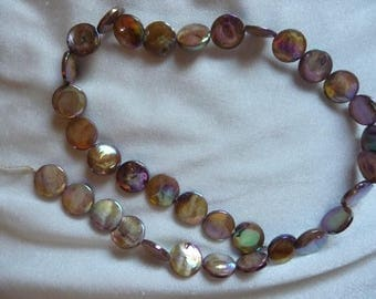 Beads, Mother of Pearl, 10mm Flat Round Coin , Shades of Gold, Very Shiny. Sold per 15 inch strand. Total of 34 beads on strand.