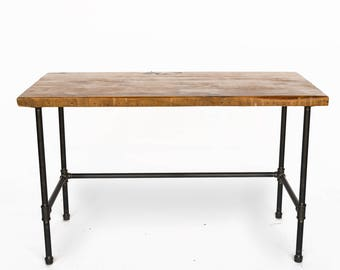 Computer Desk made with reclaimed wood and pipe legs.  Custom designs avaiable.  Choice of size, height and finish.