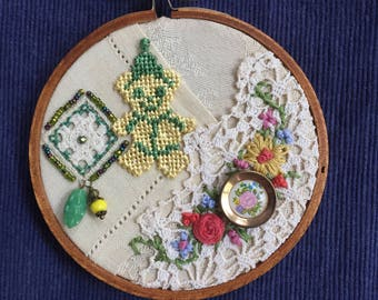 Embroidered Collage Hoop with vintage textiles, charms, beads, trim, upcycled art