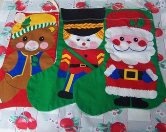 three darling hand crafted stockings