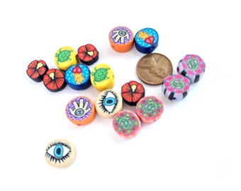 Vintage polymer clay beads with millefiori images inhalf inch size, by Marie Segal