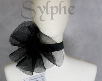 Black fantasy ruffle neck asymmetric collar with delicate soft horsehaire style back velcro closure on elastic neck band