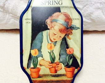 Vintage Spring GOOD HOUSEKEEPING Tin Container with 1928 Advertising Collectible Yellow Blue