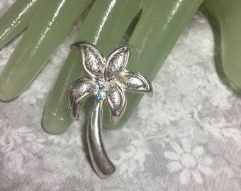 "Vintage 2"" Silvertone Light Blue Rhinestone Palm Tree Pin"