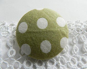 Green fabric with polka dots, 32 mm in diameter