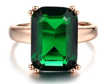 Emerald and rose gold plated ring