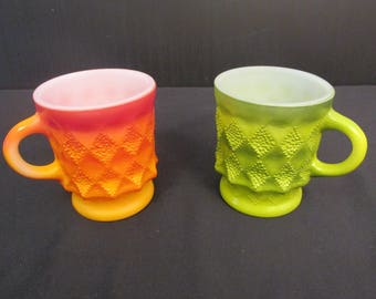 A Pair of Fire King Kimberly Coffee Mugs. / Cups - One Orange and One Green