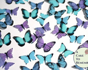 "48 small teal, blue and purple edible butterflies, 1/2- 3/4"" across. More colors available. Wafer paper butterflies for cake pops, cupcakes."