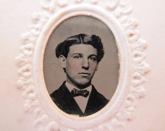 antique tintype with paper frame - young man, rosy cheeks