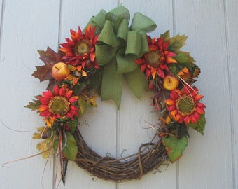 Rich Fall Grapevine Wreath Fall Foliage Deep Reds Oranges Golds Greens accented with Apples Acorns Feathers 20 inch