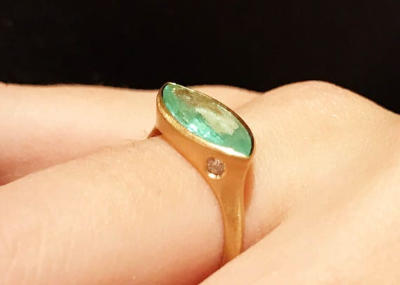 Untreated neon brazilian Paraiba Tourmaline ring in solid 22k gold with diamonds