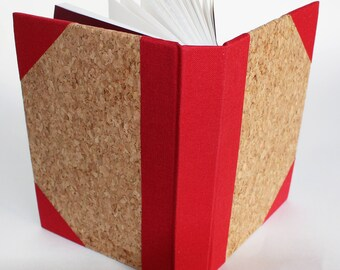 A6 pocket chunky hardback artists sketchbook, notebook or journal portrait format, in cork with bookcloth reinforced red spine and corners
