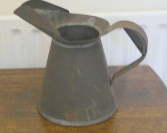 vintage half gallon oil can jug