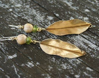 slim brass leaf earrings with natural clay and recycled olive glass beads