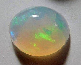 Welo crystal opal  designer cabochon Oval Red ,yellow and green shooting star fire  solid cab 3.78 ct