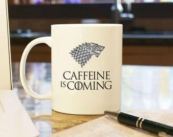 """Game of Thrones Coffee Mug Cup """"Caffeine is Coming"""" Funny """"Winter is Coming"""" House Stark Winterfell Wolf Logo Gift Present Office Home Decor"""