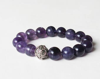 Amethyst crystal bracelet with sterling silver bali focal bead strung onto sturdy elastic