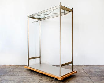 Plated and Glass Clothes Rack on Wood Base