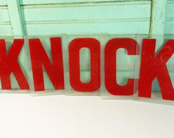 Five Vintage Clear and Red Plastic Marquee Sign Letters Spelling KNOCK