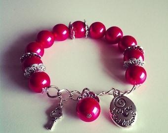 #61 red charm bracelet