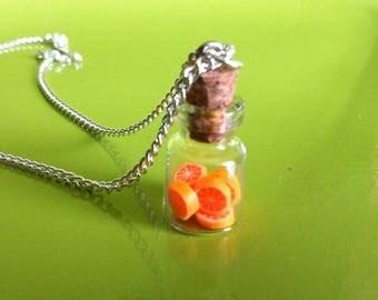 Orange vial pendant chain necklace