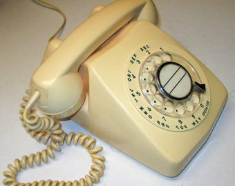 Vintage ivory-color rotary dial phone