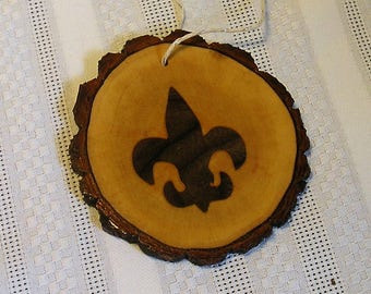 Inlaid fleur de lis, natural tree slice, with live edge