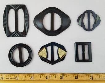 Six Vintage Black Plastic Buckles
