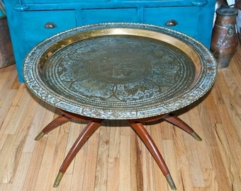 Vacay SALE...ships 7/8... Vintage Chinese brass top table with folding wooden base...etched brass coffee table…brass tray table…good fortune