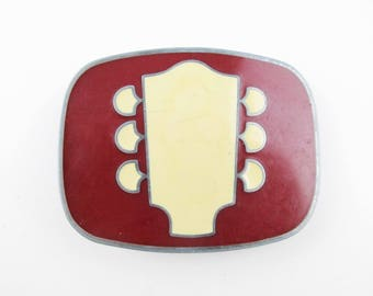 A 'Guitar Head' -  'JJ' Enameled Belt Buckle  - Maroon and Cream Enameling - Worn and Scuffed - Collectors - Enameling
