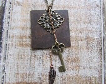 Vintage filigree angel wing key necklace