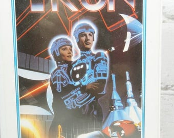 ON SALE Tron VHS Tape. 1980's Science Fiction Movies. The Grid. Light Cycles. Jeff Bridges. Bruce Boxleitner.  Walt Disney Home Video. Movie