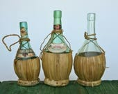 3 Chianti bottles with straw bases