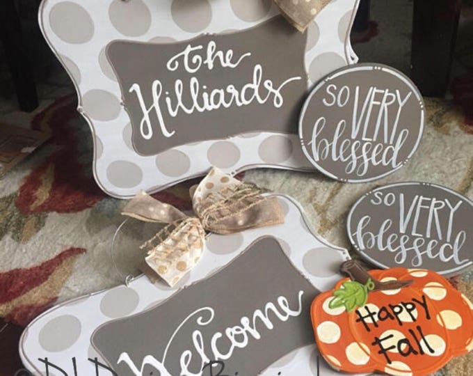 neutral personalized door hanger with polka dots and hand lettering