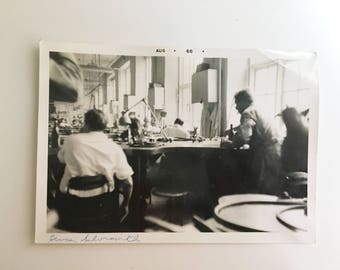 vintage black and white photo of group of silversmiths in factory room