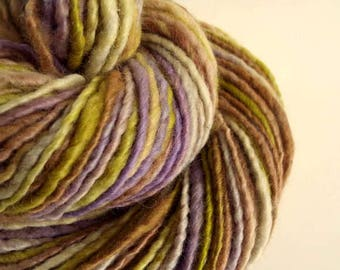 Handspun knitting yarn, handpainted chunky yarn, blue faced leicester fibre, chartreuse green, lilac and caramel browns, thick bulky wool