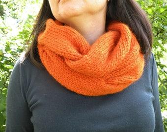 Knitting orange infinity scarf Autumn