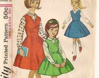 "A Sleeveless, V-Neck, 6-Gore Skirt Jumper and Long Sleeve, Small Collar Blouse Sewing Pattern - Girls Size 8, Breast 26"" • Simplicity 5223"