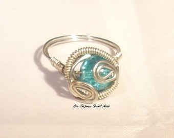 Ring wire wrapped in copper wire and turquoise crackled glass beads