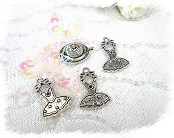 set of 4 metal charms silver
